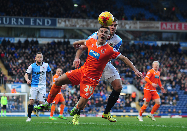 Blackpool's Dom Telford is fouled by Blackburn Rovers' Tommy Spurr<br /> <br /> Photographer Chris Vaughan/CameraSport<br /> <br /> Football - The Football League Sky Bet Championship - Blackburn Rovers v Blackpool - Saturday 21st February 2015 - Ewood Park - Blackburn<br /> <br /> &copy; CameraSport - 43 Linden Ave. Countesthorpe. Leicester. England. LE8 5PG - Tel: +44 (0) 116 277 4147 - admin@camerasport.com - www.camerasport.com
