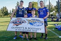 Picture by Brendon Ratnayake/SWpix.com - 14/02/2018 - Rugby League - Dacia World Club Challenge - Melbourne Storm v Leeds Rhinos - Gosch's Paddock, Melbourne, Australia - young Rhinos fans take a photo with players holding a banner