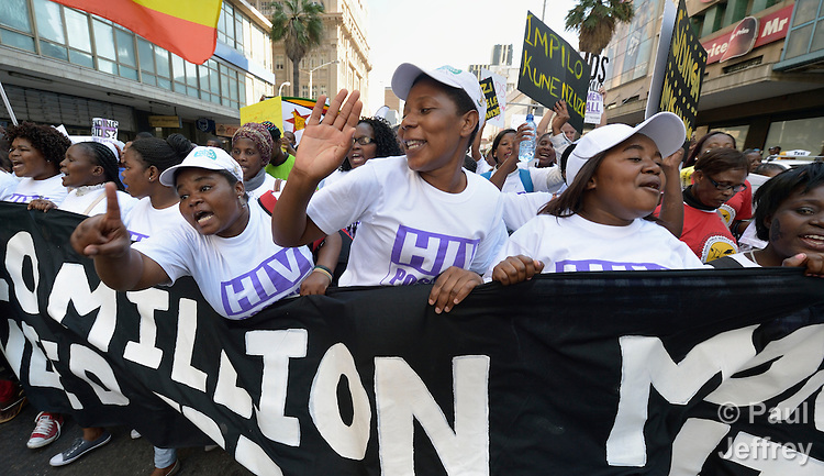 Demonstrators sing and chant as they march through the streets of Durban, South Africa, demanding better funding for HIV and AIDS treatment around the world. The demonstration took place on the first day of the 2016 International AIDS Conference in Durban.