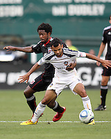 Clyde Simms #19 of D.C. United grabs Juninho #19 of the Los Angeles Galaxy during an MLS match at RFK Stadium on July 18 2010, in Washington D.C. Galaxy won 2-1.