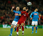 Mohamed Salah of Liverpool and Mario Rui of Napoli  during the UEFA Champions League match at Anfield, Liverpool. Picture date: 27th November 2019. Picture credit should read: Andrew Yates/Sportimage