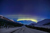 Aurora borealis swirls across the sky over interior Alaska and the James Dalton Highway.