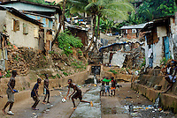Kroo Bay, Freetown, Sierra Leone...Story on child and maternal health in the Kroo Bay slum community in Freetown, Sierra Leone, which has the World's worst infant and maternal mortalitly rates. One in 4 children die before they reach the age of 5 and one in 6 mothers dies during child birth (in the UK, the rate is one in 3,800)...The Kroo Bay Community Health Centre has a catchment area of over 8,000 people but lacks adequate facilites to provide even basic care. The clinic lacks even the basics, such as bedpans, surgical spirits and cotton wool. It has no electricity and clean drinking water must be fetched from the nearby well everyday...Children play along Sanders Brook, which is often blocked up by rubbish thrown into the city's gutters and washed down stream. During the rainy season this causes heavy flooding. As there is no sanitation in the community people regularly defecate in this water...© 2007 Aubrey Wade. All rights reserved.
