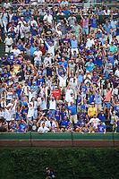 Chicago Cubs fans celebrate a Dexter Fowler (not pictured) home run during a game against the Milwaukee Brewers on August 13, 2015 at Wrigley Field in Chicago, Illinois.  Chicago defeated Milwaukee 9-2.  (Mike Janes/Four Seam Images)