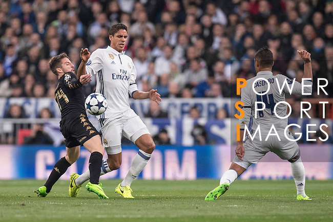 Raphael Varane of Real Madrid fights for the ball with Dries Mertens of SSC Napoli Real Madrid vs Napoli, part of the 2016-17 UEFA Champions League Round of 16 at the Santiago Bernabeu Stadium on 15 February 2017 in Madrid, Spain. Photo by Diego Gonzalez Souto / Power Sport Images