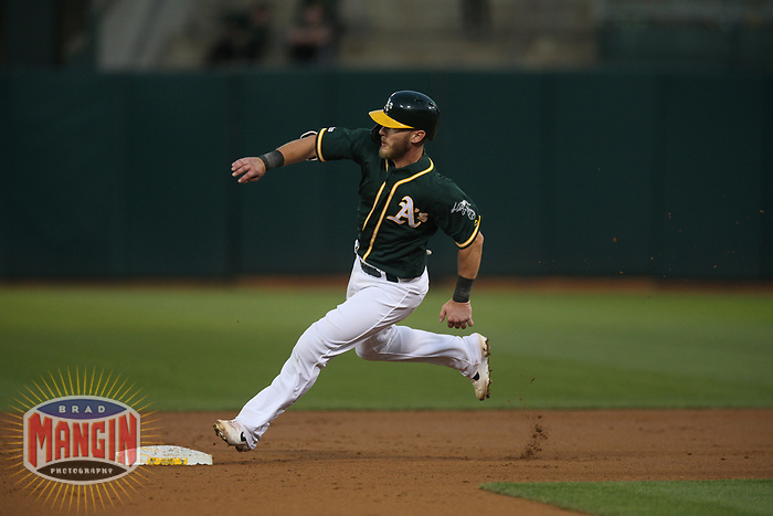OAKLAND, CA - AUGUST 20:  Corban Joseph #56 of the Oakland Athletics runs the bases against the New York Yankees during the game at the Oakland Coliseum on Tuesday, August 20, 2019 in Oakland, California. (Photo by Brad Mangin)