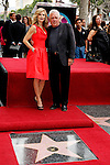 "US actress Kyra Sedgwick is with 'The Closer' cast member G.W.Bailey as she receives the 2,384th Star on the Hollywood Walk of Fame, Los Angeles, California, USA, on June  8, 2009. Kyra Sedgwick was born in New York in 1965 and grew up in Manhattan.  She made her professional acting debut at the age of 16 on the soap opera ""Another World."" .Photo by Nina Prommer/Milestone Photo"