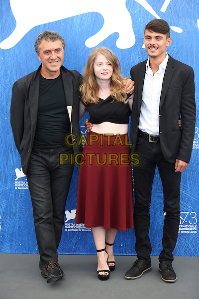 ENICE, ITALY - SEPTEMBER 08:  Director Reha Erdem, actress Ecem Uzun and actor Berke Karaer  attends a photocall for 'Big Big World' during the 73rd Venice Film Festival at Palazzo del Casino on September 8, 2016 in Venice, Italy.<br /> CAP/GOL<br /> &copy;GOL/Capital Pictures