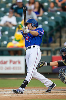 Round Rock Express shortstop Josh Wilson (2) swings the bat during the Pacific Coast League baseball game against the Omaha Storm Chasers on June 1, 2014 at the Dell Diamond in Round Rock, Texas. The Express defeated the Storm Chasers 11-4. (Andrew Woolley/Four Seam Images)