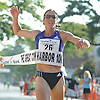 Brianne Nelson, 34, of Golden, CO (Bib No. 26) successfully defends her 2014 win by crossing the finish line of Northport's annual Cow Harbor 10-kilometer run on Saturday, September 19, 2015. The back-to-back first place female finisher clocked a time of  time of  32:53.15.<br /> <br /> James Escher