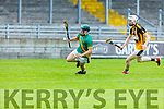 Maurice O'Connor of Kilmoyley in possession against James O'Connor of Abbeydorney in R2 of the Garvey Supervalu Hurling Championship on Sunday.