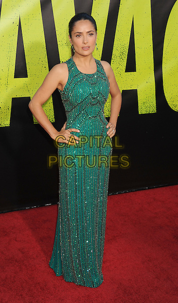 "Salma Hayek.arriving at the Los Angeles premiere of ""Savages"" at Mann Village Theatre in Westwood, California, USA, .June 25th, 2012..full length green long maxi dress hands on hips beaded sleeveless .CAP/ROT/TM.©TM/Roth Stock/Capital Pictures"