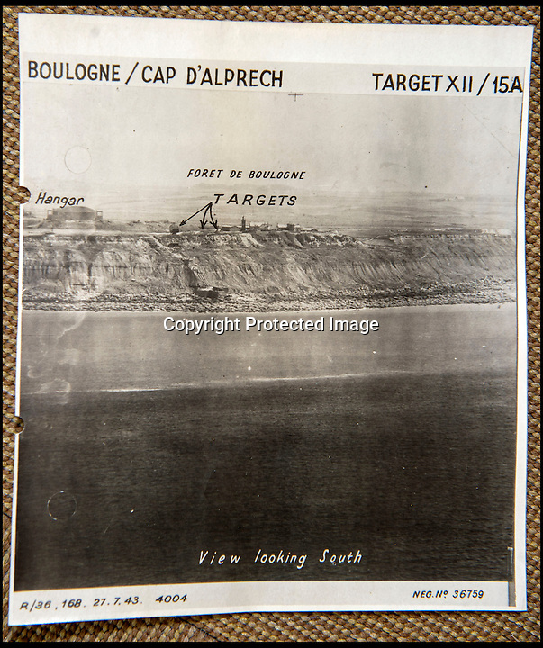 BNPS.co.uk(01202 558833)<br /> Pic: C&TAuctions/BNPS<br /> <br /> Diversionary attack plans with targets marked for the cliffs west of Boulogne.<br /> <br /> Found in a french flea market - a Top Secret 'how to' guide to D-Day.<br /> <br /> Fascinating top secret documents and photos of the extensive planning that went into the Normandy invasion have emerged after 72 years.<br /> <br /> Incredibly detailed plans of Nazi defences, high resolution photographs, weekly intel reports and even analysis of the German weapons they were likely to face are included in the sale.<br /> <br /> One photo taken at zero feet shows German troops scattering across a beach as a low-level RAF aircraft sweeps by to capture the plethora of anti-landing obstacles.<br /> <br /> Other images show the famous coastline with key cliff-top targets that had to be destroyed either before or on D-Day itself.<br /> <br /> The archive is being sold by C&T Auctions of Kent.
