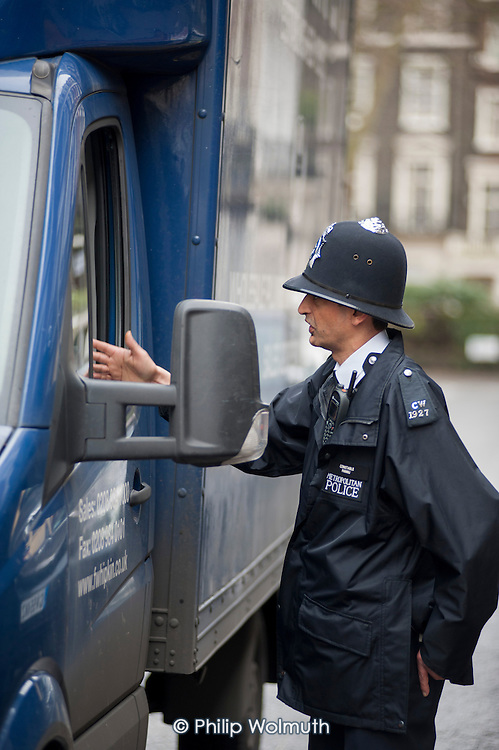 Metropolitan Police Constable deals with motorists, Paddington.