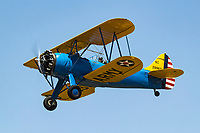 1940 Waco UPF-7 biplane in U.S Army markings in flight during the 2017 Nevada County Airfest
