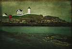 Nubble Lighthouse on the coastline of Maine, USA, on a late autumn afternoon with added textures.