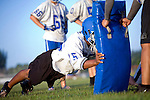 MAE GAMMINO/SPECIAL TO SCRIPPS TREASURE COAST NEWSPAPERS<br /> <br /> Getting the tackle down, players practice moves during the first day of practice for Sebastian River High School football.