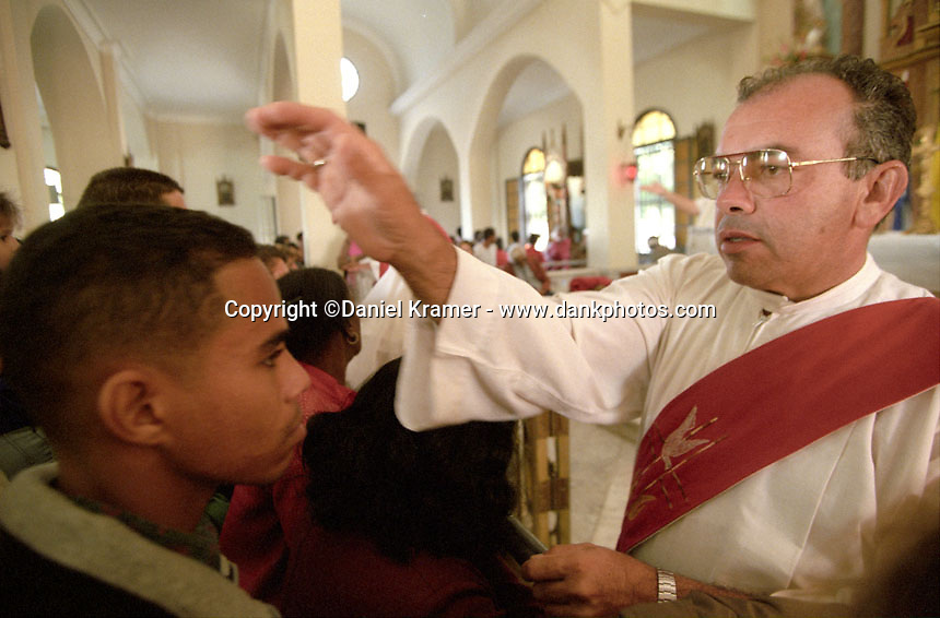 A priest gives a man a blessing in Havana in 1998.