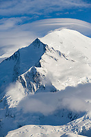 Lenticular clouds over the North Peak of Denali, in the foreground, Pioneer Ridge is a long, serrated knife-edge that stretches from Denali's North Face.