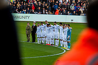 Players observe a minutes silence ahead of the Premier League match between Swansea City and Manchester United at The Liberty Stadium, Swansea, Wales, UK. SUnday 06 November 2016.