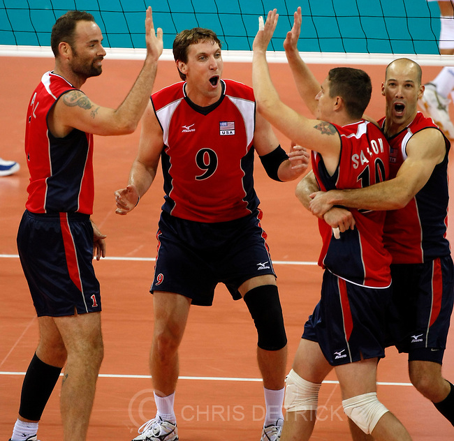 USA's Lloy Ball, #1, Ryan Millar, #9, Riley Salmon, #10, and William Priddy, #8, celebrate after winning a point during the quarterfinals match at the Capital Gymnasium in Beijing, Wednesday, August 20, 2008. USA defeated Serbia 3-2. Millar, 30-year-old Highland resident and former Brigham Young All-American and coach, is making his third Olympic appearance at the Beijing Games..Chris Detrick/The Salt Lake Tribune.