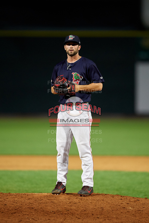 Lowell Spinners relief pitcher Andrew Politi (63) gets ready to deliver a pitch during a game against the Vermont Lake Monsters on August 25, 2018 at Edward A. LeLacheur Park in Lowell, Massachusetts.  Vermont defeated Lowell 4-3.  (Mike Janes/Four Seam Images)