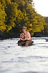 Woman fly fishing on a river in Central Vermont. 2010.