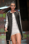 A model walks the runway during the Czar by Cesar Galindo  show at the second night of Fashion Houston at the Wortham Theater Monday Oct. 10,2011.(Dave Rossman/For the Chronicle)