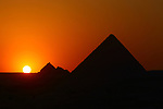 Sunset in Pyramid of Menkaure and Queens Pyramids at Giza Plateau