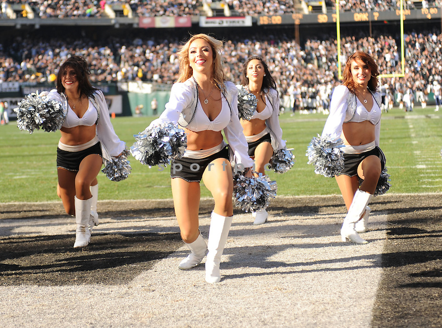 CHEERLEADERS, of the Oakland Raiders, in action during the Raiders game against the San Diego Chargers on January 1, 2012 at O.co Coliseum in Oakland, CA. The Chargers beat the Raiders 38-26.