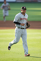 Delmarva Shorebirds third baseman Jomar Reyes (20) jogs off the field between innings of the game against the Kannapolis Intimidators at CMC-Northeast Stadium on June 4, 2015 in Kannapolis, North Carolina.  The Shorebirds defeated the Intimidators 8-2.  (Brian Westerholt/Four Seam Images)