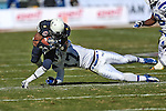 Navy Midshipmen running back Geoffrey Whiteside (29) and Middle Tennessee Blue Raiders defensive end Alexandro Antoine (17) in action during the Armed Forces Bowl game between the Middle Tennessee Blue Raiders and the Navy Midshipmen at the Amon G. Carter Stadium in Fort Worth, Texas. Navy defeated Middle Tennessee 24 to 6.