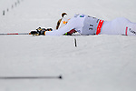 HOLMENKOLLEN, OSLO, NORWAY - March 17: Lisa Larsen of Sweden (SWE) exhausted on the ground after finishing the Ladies 30 km mass start race, free technique, at the FIS Cross Country World Cup on March 17, 2013 in Oslo, Norway. (Photo by Dirk Markgraf)