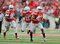 Ohio State Buckeyes linebacker Darron Lee (43) runs after picking up a fumble and returning for a touchdown during the fourth quarter of the NCAA football game against Michigan at Ohio Stadium on Saturday, November 29, 2014. (Columbus Dispatch photo by Jonathan Quilter)