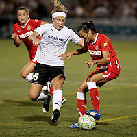 Ella Masar (55) of the magicJack, left and Marta (10) of the Western New York Flash battle for control in the second half. The Western New York Flash defeated the magicJack 3-1 in Women's Professional Soccer (WPS) at Sahlen's Stadium in Rochester, NY July 20, 2011.
