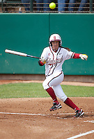 STANFORD, CA - April 2, 2011: Sarah Hassman of Stanford softball hits the ball down the third base line during Stanford's game against Arizona at Smith Family Stadium. Stanford lost 6-1.