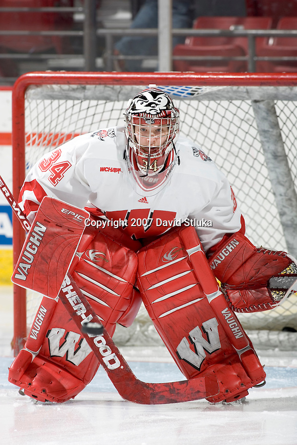 MADISON, WI - FEBRUARY 16: Goalie Christine Dufour #34 of the Wisconsin Badgers women's hockey team warms up prior to the game against the Bemidji State Beavers at the Kohl Center on February 16, 2007 in Madison, Wisconsin. The Badgers beat the Beavers 2-0. (Photo by David Stluka)