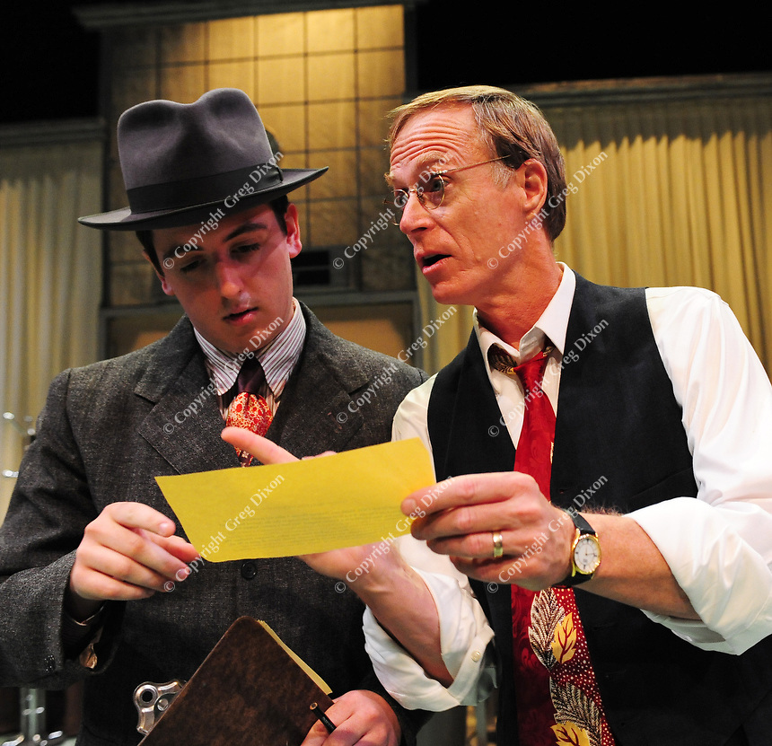 Norman Gilliland (right) looks over a breaking news announcement with Bill Tucker in University Theatre's War of the Worlds.
