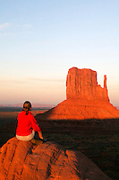 A visitor enjoys the view of Monument Valley Navajo Tribal Park, Arizona.  (Model released)