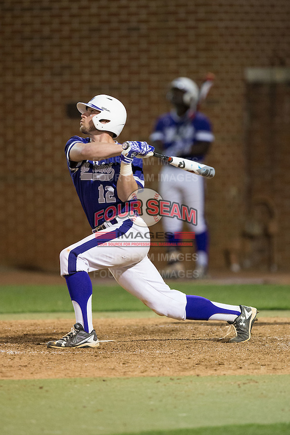Blake Schunk (12) of the High Point Panthers follows through on his swing against the NJIT Highlanders during game two of a double-header at Williard Stadium on February 18, 2017 in High Point, North Carolina.  The Highlanders defeated the Panthers 4-2.  (Brian Westerholt/Four Seam Images)