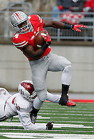 Ohio State Buckeyes running back Curtis Samuel (4) breaks from Indiana Hoosiers safety Chase Dutra (30) in the first quarter of their game at Ohio Stadium in Columbus, Ohio on November 22, 2014. (Columbus Dispatch photo by Brooke LaValley)