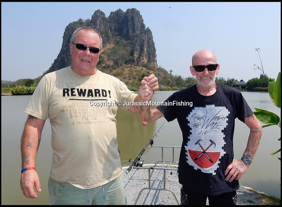 BNPS.co.uk (01202 558833)<br /> Pic: JurassicMountainFishing/BNPS<br /> <br /> ***Please use full byline***<br /> <br /> Paul Fairbrass (left) and Cliff Dale with the special bait made from their friend Ron's ashes which was used to land a massive carp.<br /> <br /> Two anglers honoured their late fisherman friend by turning his ashes into a bait that snared a monster 180lbs catch.<br /> <br /> Ron Hopper, 64, died from cancer before he could go on a much-anticipated fishing holiday to Thailand with Paul Fairbrass and Cliff Dale.<br /> <br /> While Ron was on his deathbed the trio agreed Paul and Cliff, both aged 65, should take his ashes to the Far East with them and infuse them with a special bait mix to make 'boilies'.
