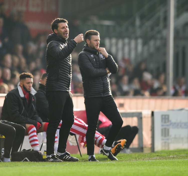 Lincoln City manager Danny Cowley, left, and Lincoln City's assistant manager Nicky Cowley shout instructions to their team from the technical area<br /> <br /> Photographer Chris Vaughan/CameraSport<br /> <br /> The EFL Sky Bet League Two - Lincoln City v Mansfield Town - Saturday 24th November 2018 - Sincil Bank - Lincoln<br /> <br /> World Copyright © 2018 CameraSport. All rights reserved. 43 Linden Ave. Countesthorpe. Leicester. England. LE8 5PG - Tel: +44 (0) 116 277 4147 - admin@camerasport.com - www.camerasport.com