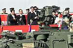 October 23, 2016, Asaka, Japan - Japanese Prime Minister Shinzo Abe and Defense Minister Tomomi Inada review the grand parade of tanks, armored vehicles and ground troops during an annual Armed Forces Day celebration in honor of Japans defense forces at the Ground Self-Forces parade ground in Asaka, outside of Tokyo, on Sunday, October 23, 2016. (Photo by Natsuki Sakai/AFLO) AYF -mis-