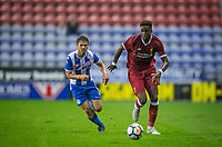 Divock Origi of Liverpool moves from Luke Burke of Wigan Athletic during the pre season friendly match between Wigan Athletic and Liverpool at the DW Stadium, Wigan, England on 14 July 2017. Photo by Andy Rowland.