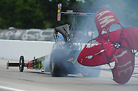 Sept. 5, 2011; Claremont, IN, USA: NHRA top fuel dragster driver Terry McMillen after exploding an engine during the US Nationals at Lucas Oil Raceway. Mandatory Credit: Mark J. Rebilas-