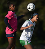 Sydney Moore #15 of Farmingdale, right, heads a ball away from Kaia Harrison #21 of Baldwin during a Nassau County Conference AA-1 varsity girls soccer game at Baldwin High School on Wednesday, Oct. 17, 2018. Moore scored a goal in the early in the second half to extend Farmingdale's lead to 3-1. The Dalers went on to win by that same score.