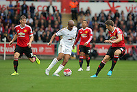 Pictured: Andre Ayew of Swansea (C) against Michael Carrick of Manchester United (R) Sunday 30 August 2015<br /> Re: Premier League, Swansea v Manchester United at the Liberty Stadium, Swansea, UK
