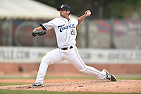 Asheville Tourists pitcher Jerry Vasto (28) delivers a pitch during a game against the Rome Braves on May 17, 2015 in Asheville, North Carolina. The Tourists defeated the Braves 9-8. (Tony Farlow/Four Seam Images)