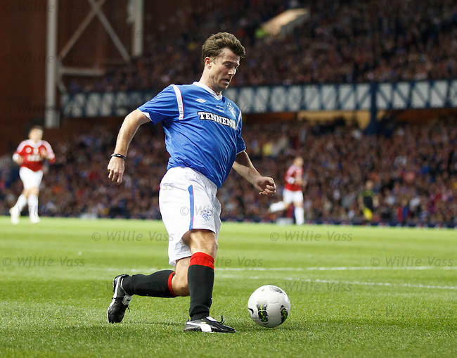 Brian Laudrup cuts back inside as he graces the Ibrox turf one last time